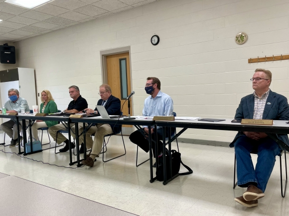 The Town of Waynesville Board of Aldermen listens to comment from DWA board members on Aug. 12.