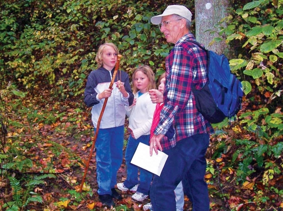 Dan Pittillo instructs a friend's young children in the ways of botany. Stan Hammer photo