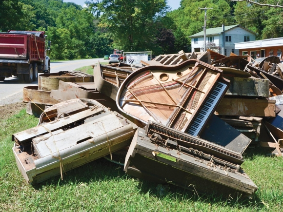 Some 9 tons of piano lies piled up in the sun outside Ward Piano on Asheville Highway, outside Canton. Cory Vaillancourt photos