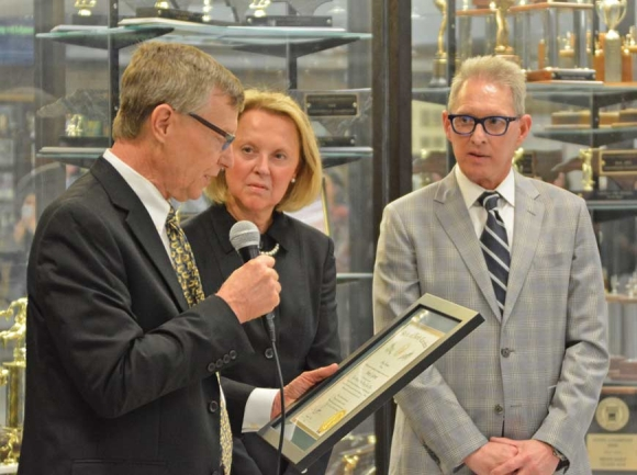 Dr. Anne Garrett (center) looks on as HCS Board Chair Chuck Francis (left) presents her with The Order of the Long Leaf Pine. Cory Vaillancourt photo
