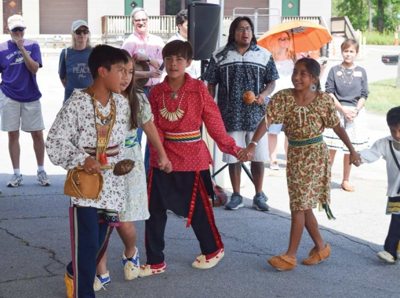 Cherokee children lead a traditional friendship dance at the Nikwasi Mound in Franklin. Barbara McRae (below, left) and Juanita Wilson, co-chairs of the Nikwasi Initiative, give the opening prayer in English and Cherokee. Jessi Stone photos