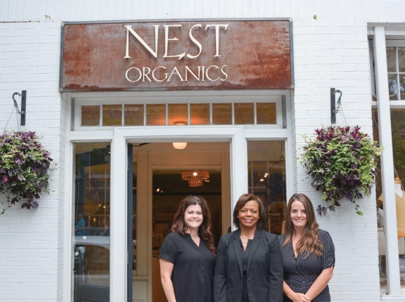 Cheri Beasley visits with Lyndsey Marlar and Katie Spears, owners of Nest Organics in Asheville. Hannah McLeod photo