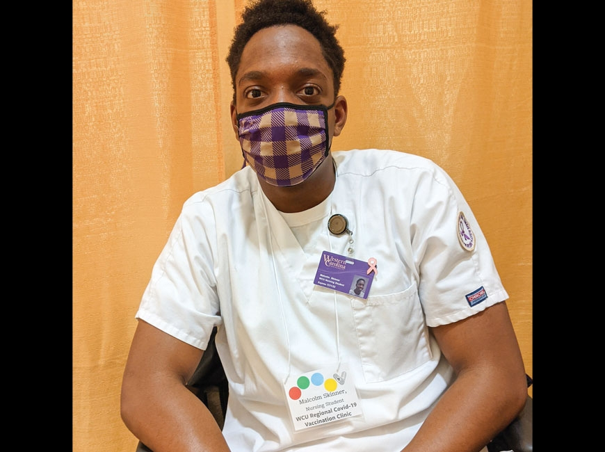 Malcolm Skinner, a nursing student at Western Carolina University, is getting hands-on experience in his chosen profession by working at the school's COVID-19 vaccine clinic. Holly Kays photo
