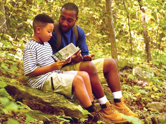 A father and son examine their progress at Chimney Rock State Park. Donated photo
