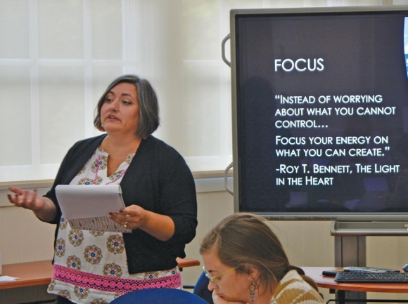 Amy Murphy-Nugen (left), chair of Waynesville's Task Force on Homelessness, presents the group's findings on July 8. Cory Vaillancourt photo