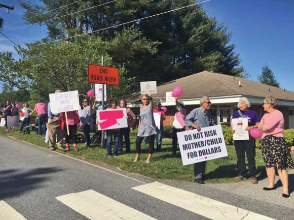 Franklin residents protest last spring after Mission Health announced it would be closing labor and delivery at Angel Medical Center. Residents are now worried about the impact HCA's purchase of Mission will have on their community hospital. File photo