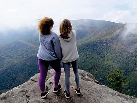The girls get a look at the Southern Nantahala Wilderness from Pickens Nose. Don Hendershot photo