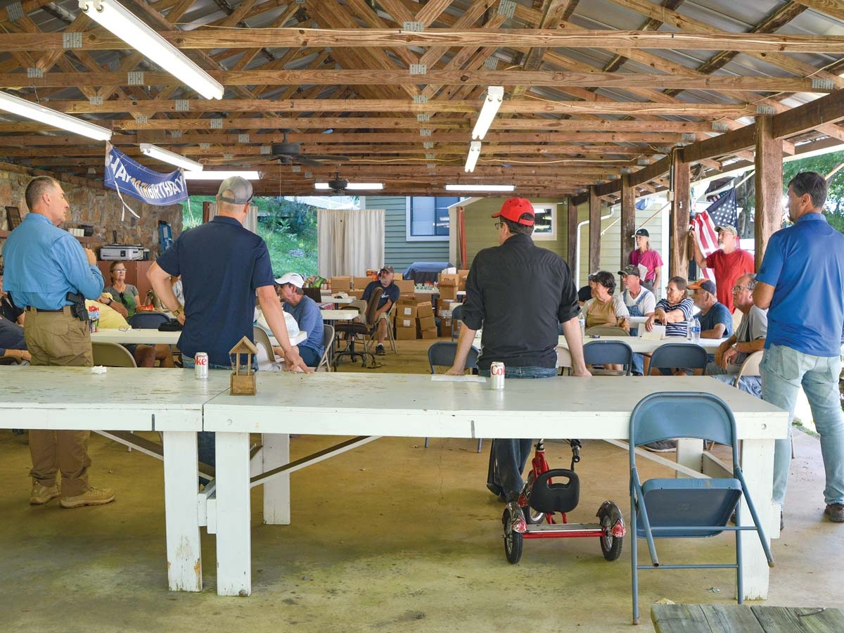 Local officials including (left to right) Sheriff Greg Christopher, Commissioner Brandon Rogers, Sen. Kevin Corbin and Rep. Mark Pless talk to residents of Laurel Bank Campground on Sept. 2. Cory Vaillancourt photo