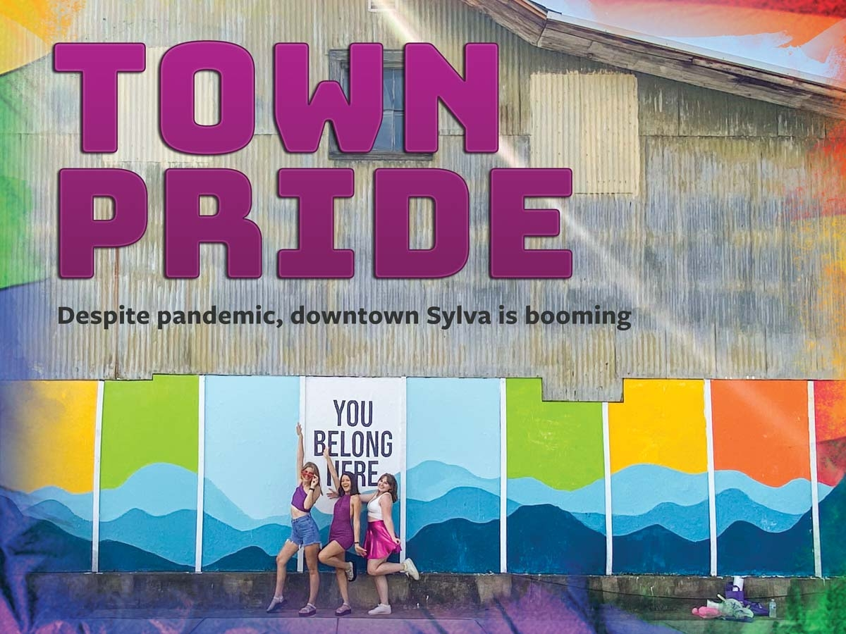 WCU students Kinley Cook, Laila Figaroa and Megan Gorman stand in front of Sylva's new mural by Worth LaRose. Hannah McLeod photo