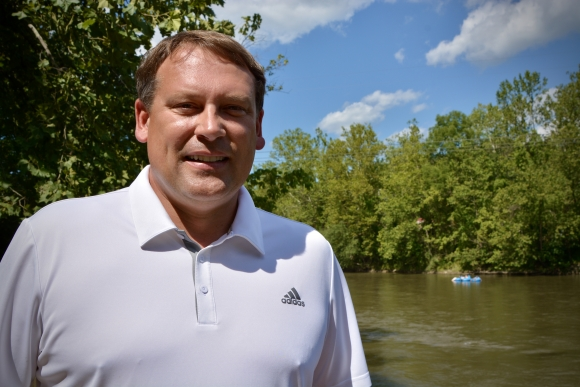 Swain County native and former NC11 Congressman Heath Shuler stands near the French Broad River in Asheville on Tuesday, Aug. 18.