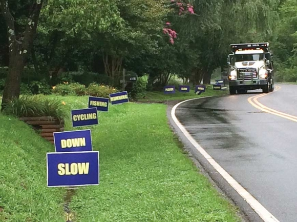 Newly posted signs ask drivers to slow down while driving South River Road. Donated photo