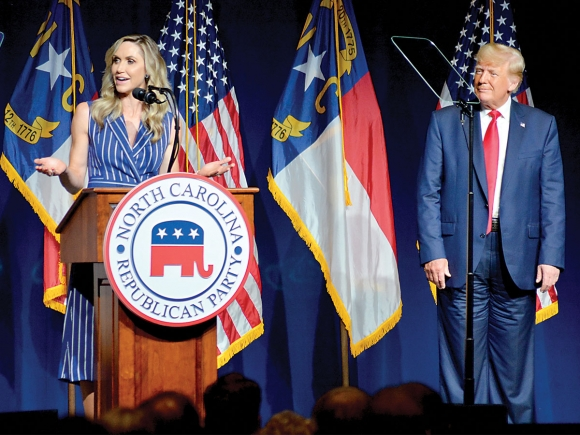 Lara Trump (left) stands with her father-in-law on June 5, 2021 in Greenville, NC.