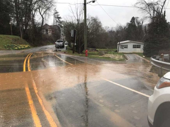 Muddy water flows down the access road to the Millennial Apartments project during a     rain event Feb. 24. Jackson County photo
