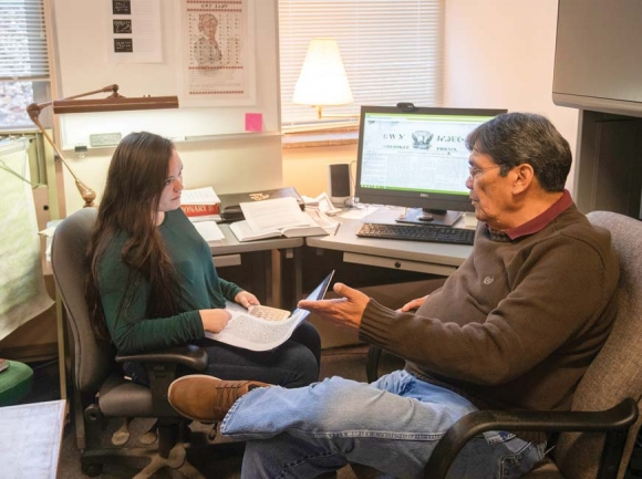 Graduate student Constance Owl (left) and Cherokee language speaker Tom Belt                go over translations from the Cherokee Phoenix newspaper, which was published from about 1828 to 1834. WCUphoto