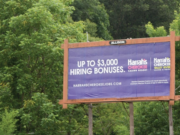 Billboard signs all along U.S. 74, like this one just outside of Waynesville, advertise Harrah's financial incentives for new hires. Holly Kays photo