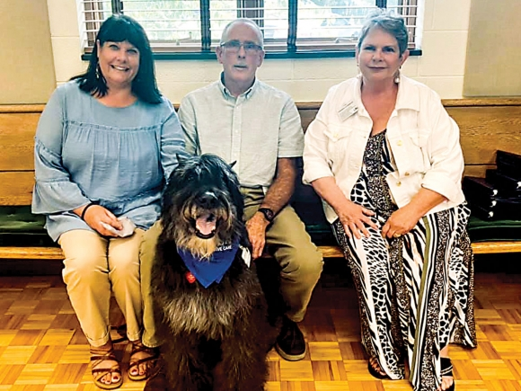 Hospice Executive Director Andrea Rogers-Ray, (from left) volunteer Bill Hoke and Cody, and Hospice Volunteer Coordinator Beverly Murray are pictured at a volunteer appreciation event.